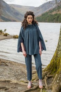 Pleated blue tweed cape and matching trouser pants